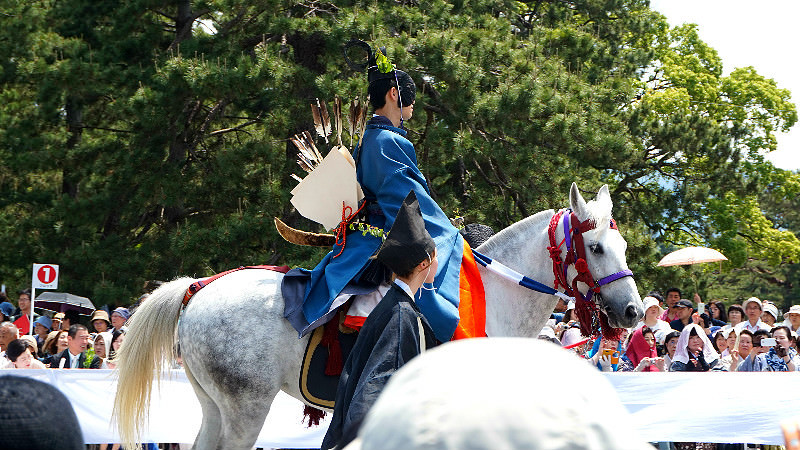 men who wear clothes from Heian Era riding on the horses